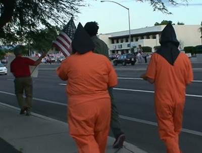 Several Protesters Wearing Orange