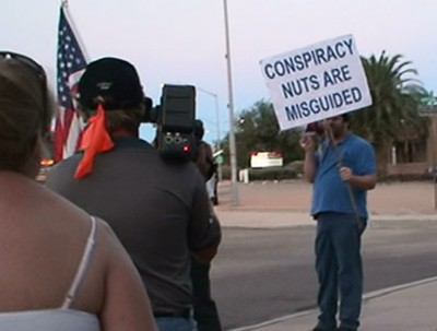 Sign - Conspiracy nuts are misguided